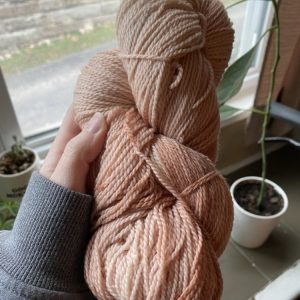 Pink yarn hand dyed with natural dye made from avocado skins