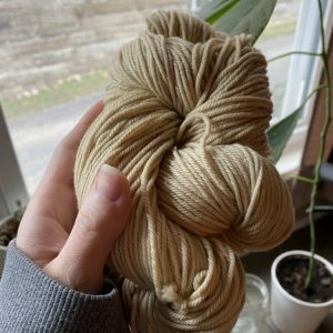 Yellow yarn hand dyed with natural dye made from goldenrod flowers